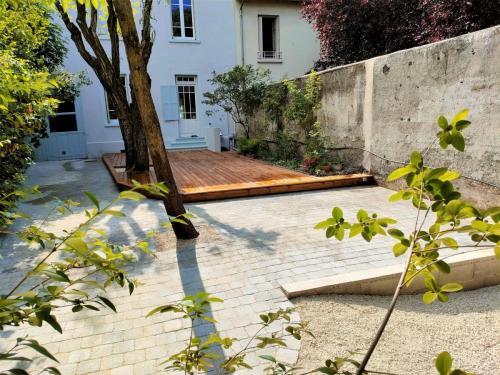 Terrasse bois et pavé béton